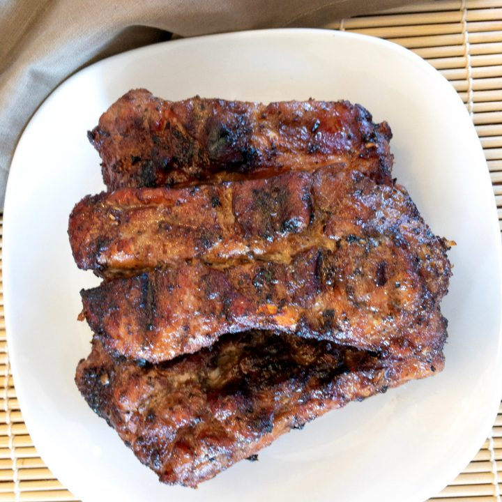 Pork ribs are marinated in a ginger, garlic, and coconut aminos marinade and then grilled to perfection.