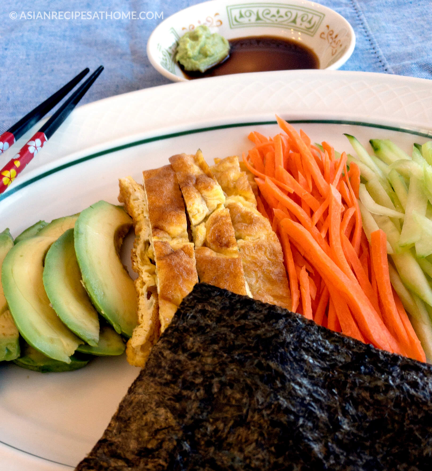 Nori wraps with eggs, avocado, and fresh vegetables is a quick and easy way to whip up a fresh and healthy meal or snack.
