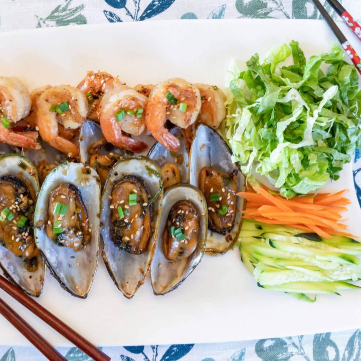 New Zealand Mussels on the half shell and shrimp are cooked in a garlic Asian sauce that is soy-free, gluten-free, Paleo and Whole30 compliant.