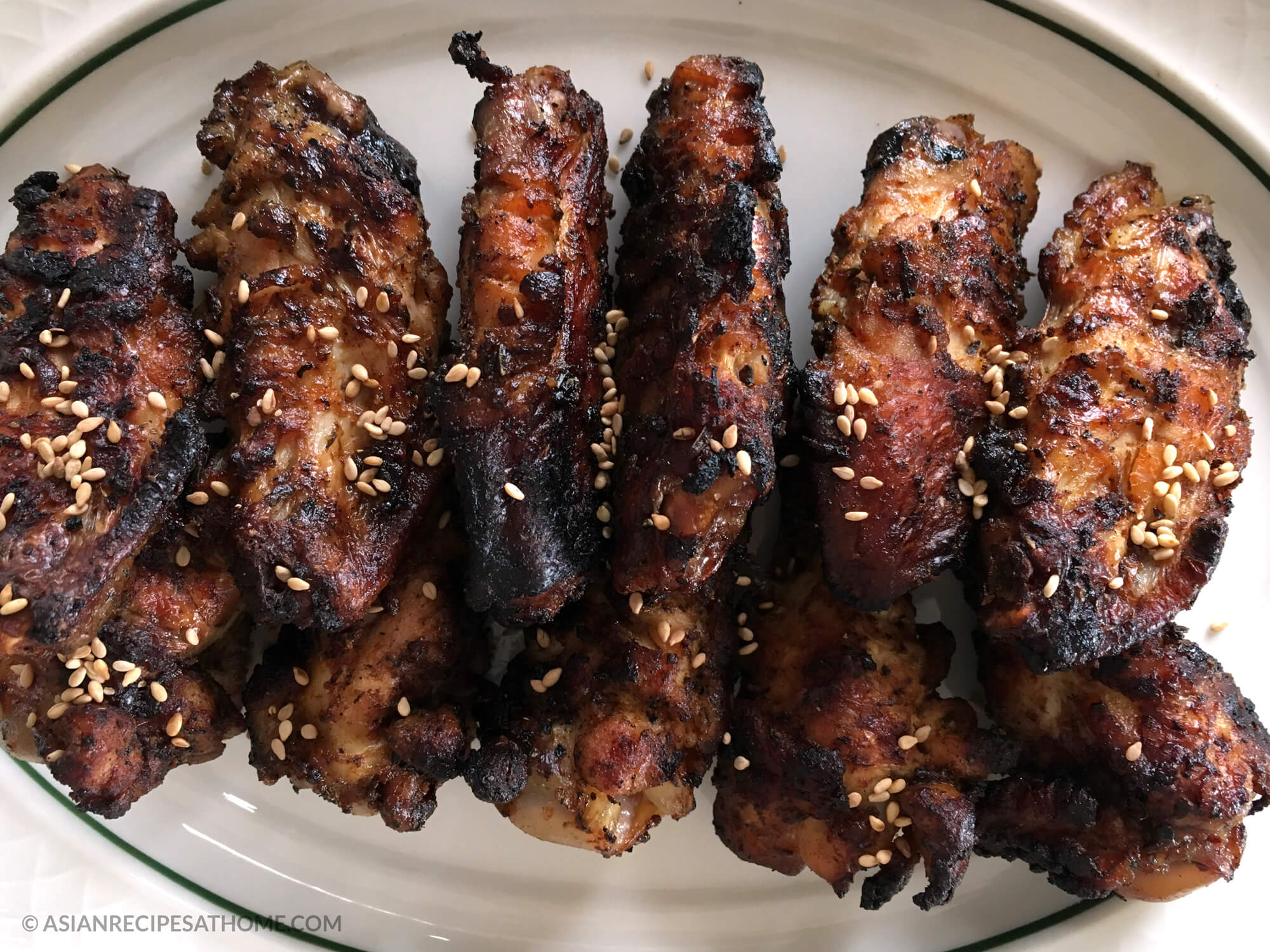 These chicken wings are grilled to perfection in an Asian inspired sauce.