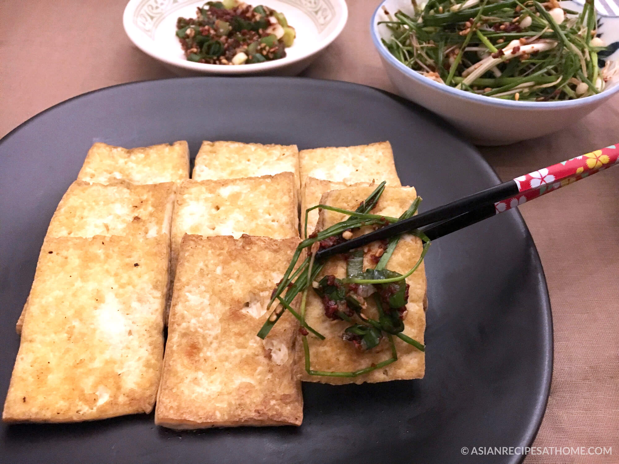 This pan-fried tofu is easy to make, healthy, and full of flavor thanks to our simple dipping sauce.