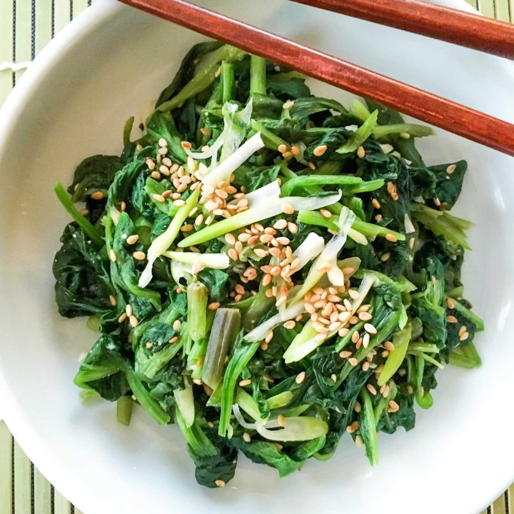 This Korean seasoned spinach side dish (sigeumchi-namul) recipe is made of blanched spinach, green onions, soy sauce, sesame seed oil, minced garlic, sesame seeds, salt and pepper.