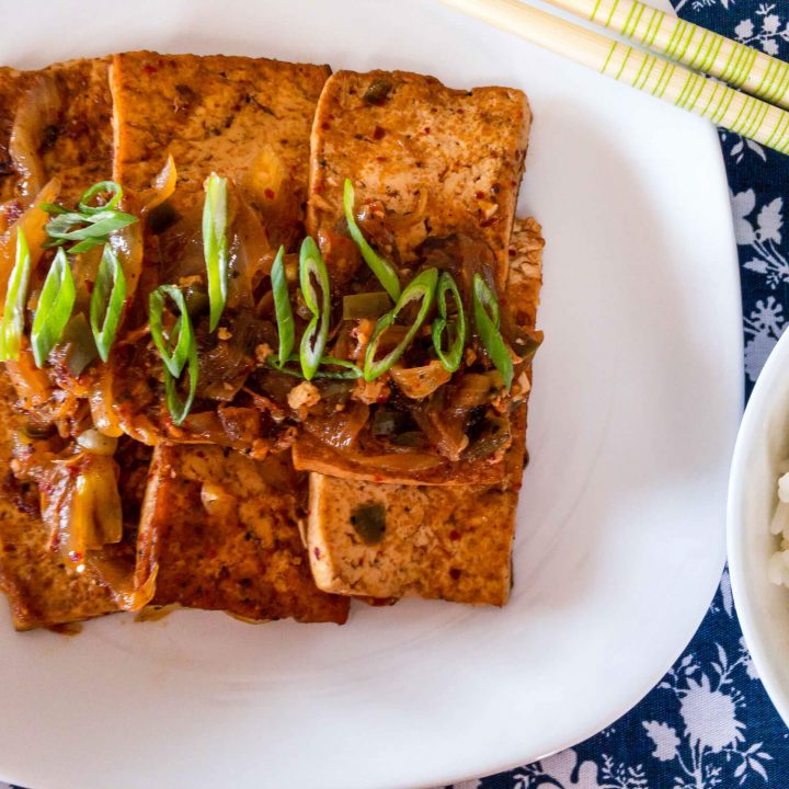 This flavorful braised tofu is a simple recipe that is made with pan-fried tofu that's braised in a spicy Korean sauce.