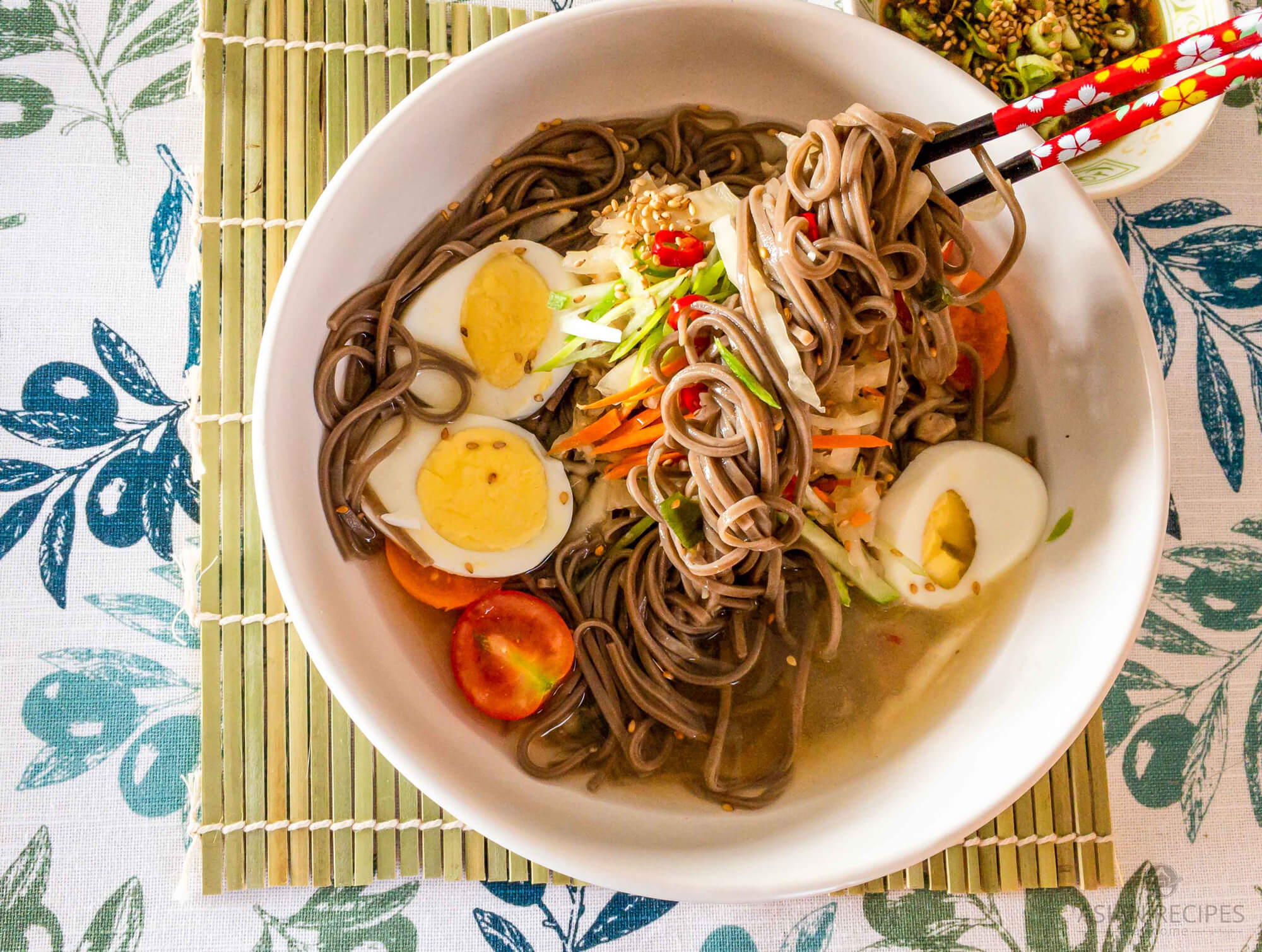 Korean-style cold buckwheat noodles served in a delicious chilled broth made from Kombu seaweed, dried anchovies, and juices from white kimchi.