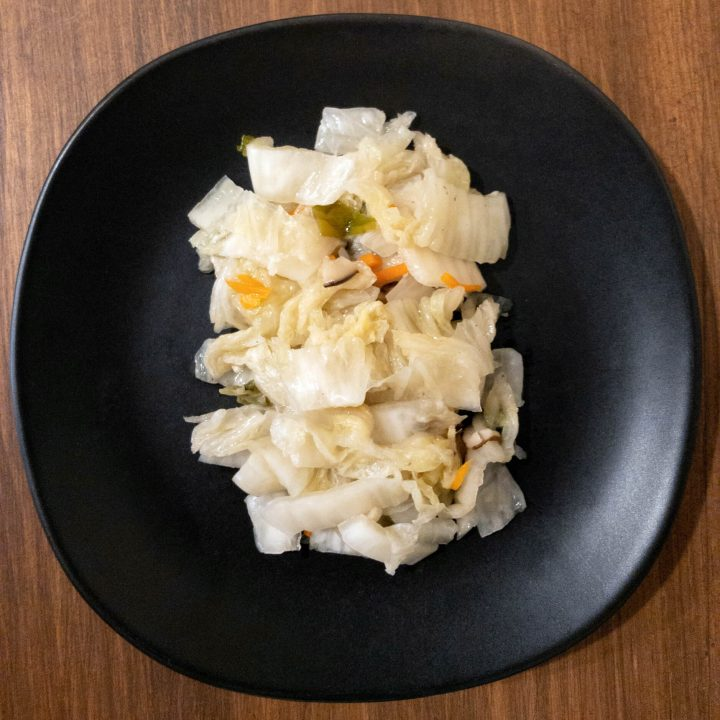 Korean white kimchi (Baek kimchi) is a napa cabbage kimchi that is not spicy and has a clean and refreshing flavor.