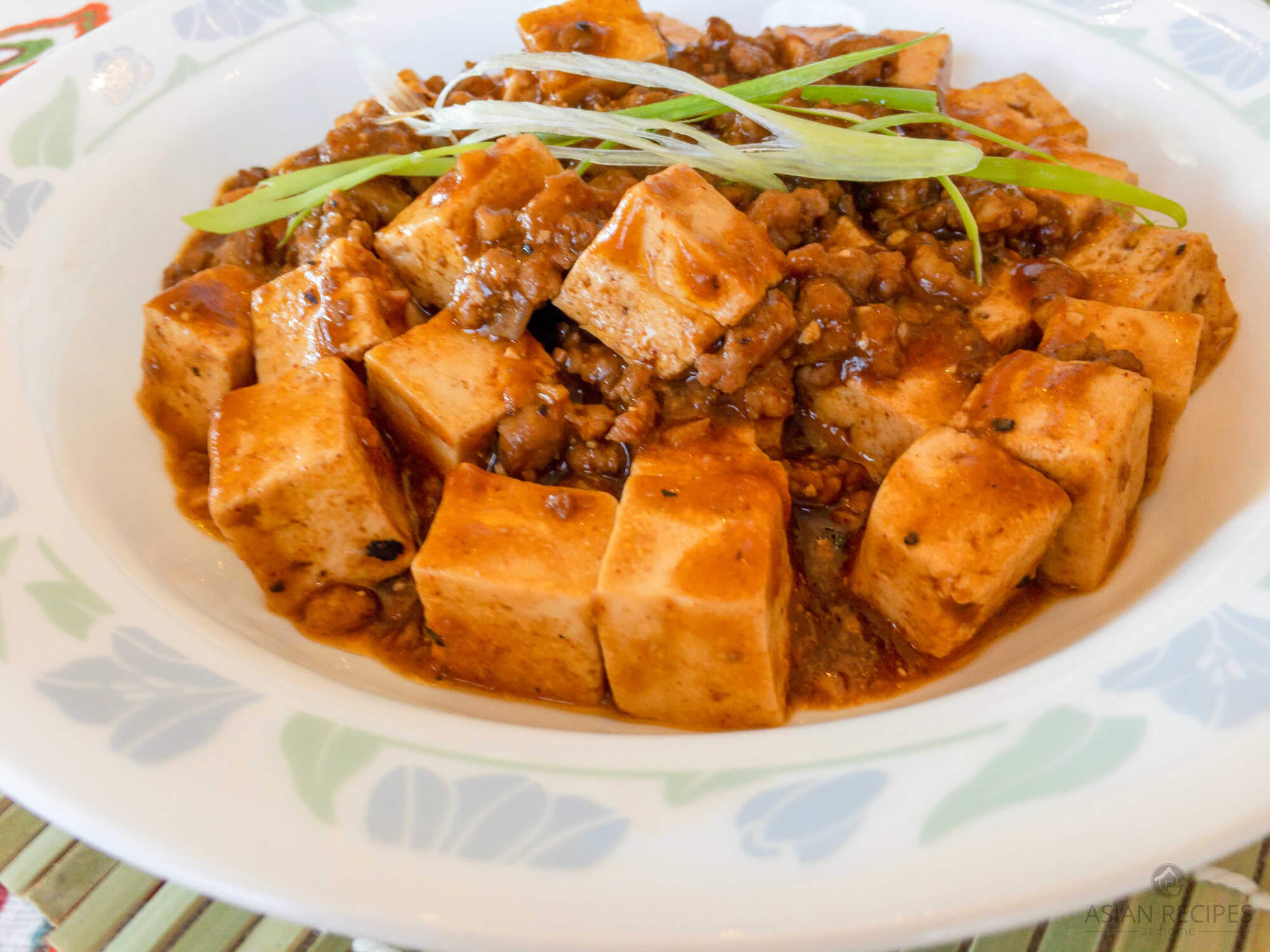 This tofu with spicy meat sauce recipe is our take on mapo tofu. This recipe is hearty and packed with protein and simmered in a spicy sauce.