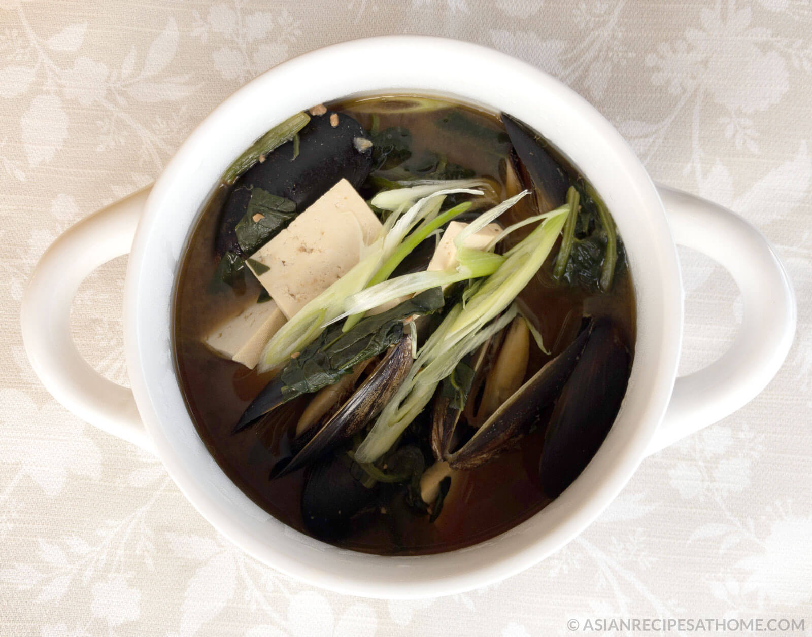 This Korean spinach and mussel fermented soybean (doenjang) soup is so easy to make and will make you feel good about eating it.
