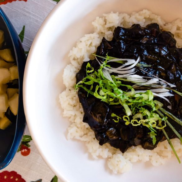 Our Korean-Chinese jjajang rice (jjajangbap 짜장밥) recipe consists of a delicious black bean sauce poured on top of a bed of rice.