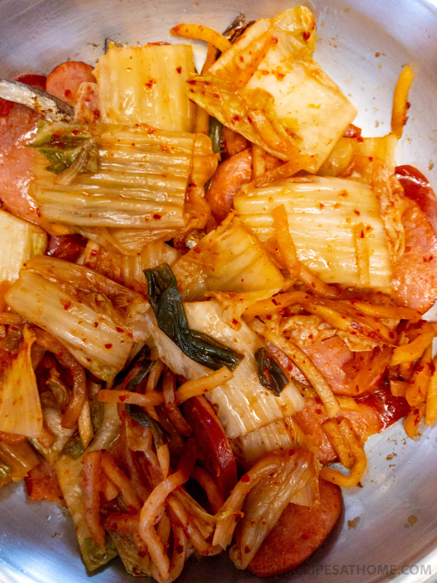 Adding in our kimchi to the pot