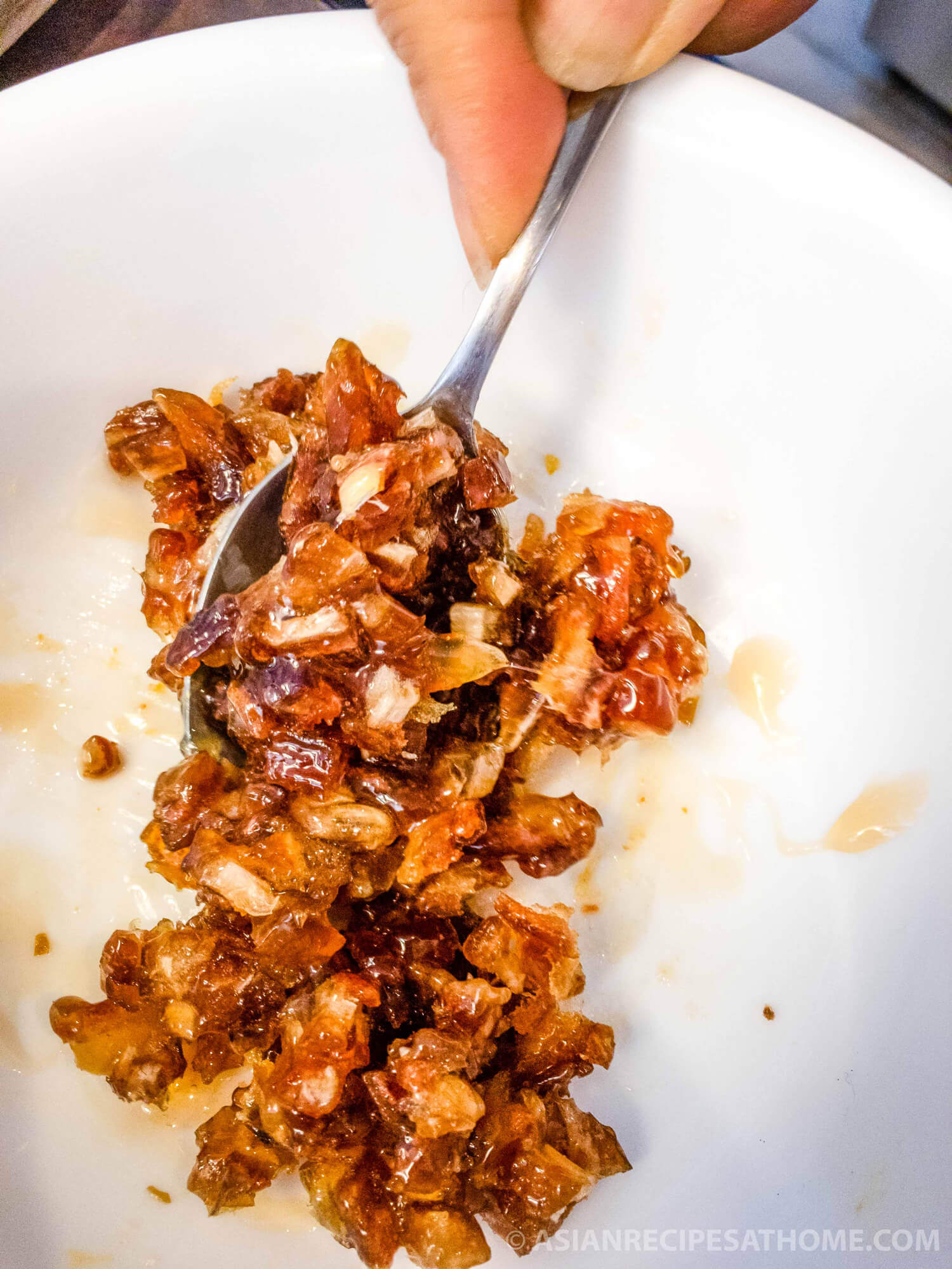 Mix the dates with honey for the sweet rice cakes filling.
