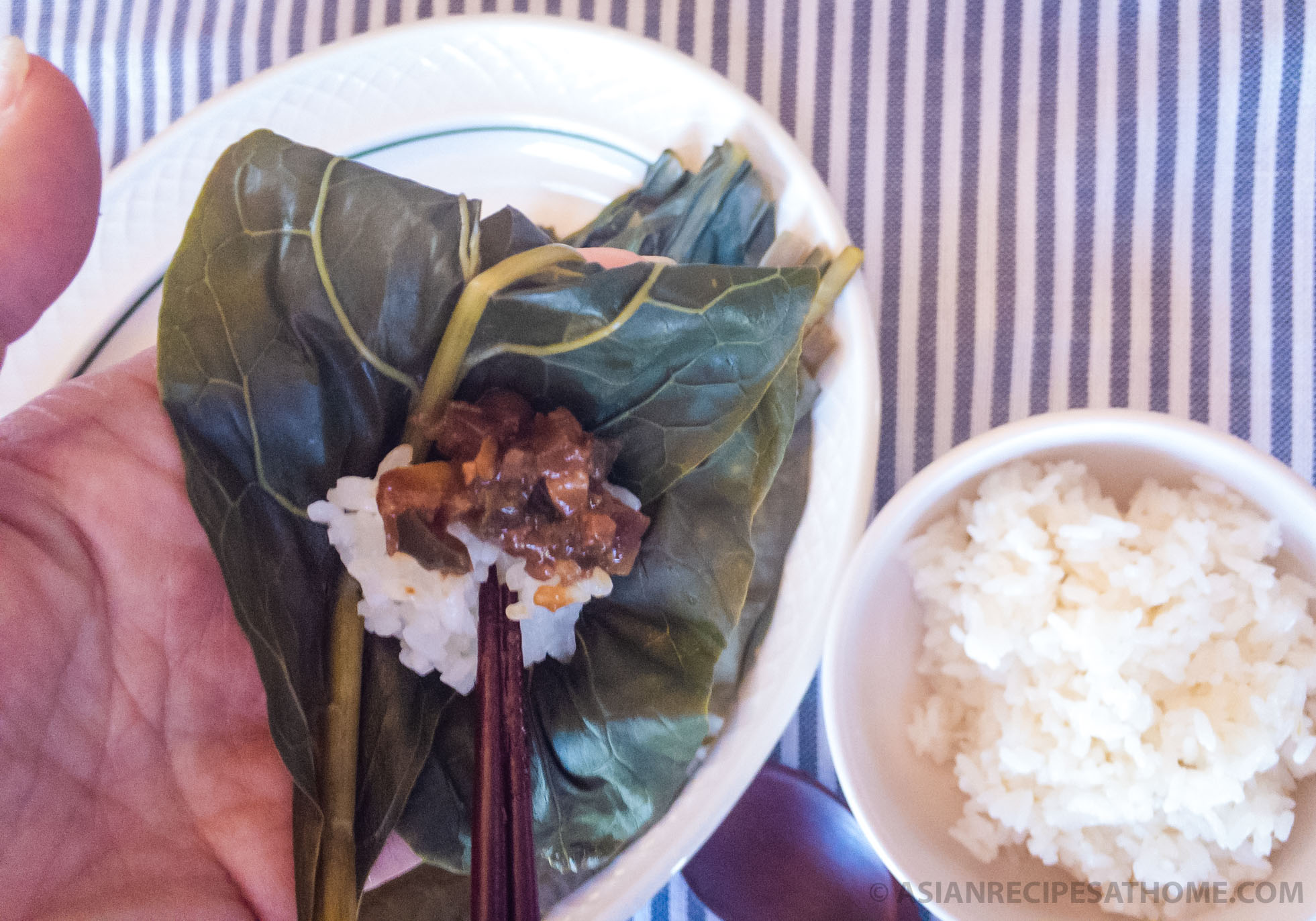 Boiled poke salad (sallet) leaves are used as the wrap for the rice and the savory, salty Korean fermented soybean paste sauce.