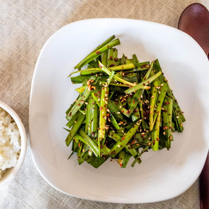 This Korean garlic chives salad (buchu muchim) is spicy, healthy, & is incredibly easy to make.
