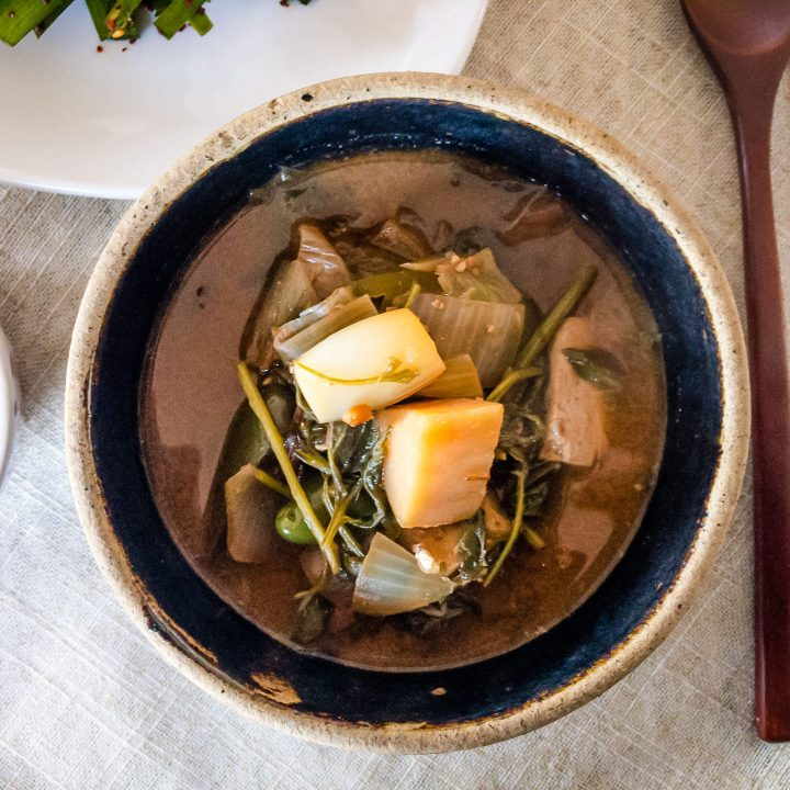 This Korean soybean paste stew (doenjang guk) is filled with delicious mugwort greens, wild Korean chives, tofu, potatoes, and the salty/umami flavors of fermented soybean paste (doenjang).