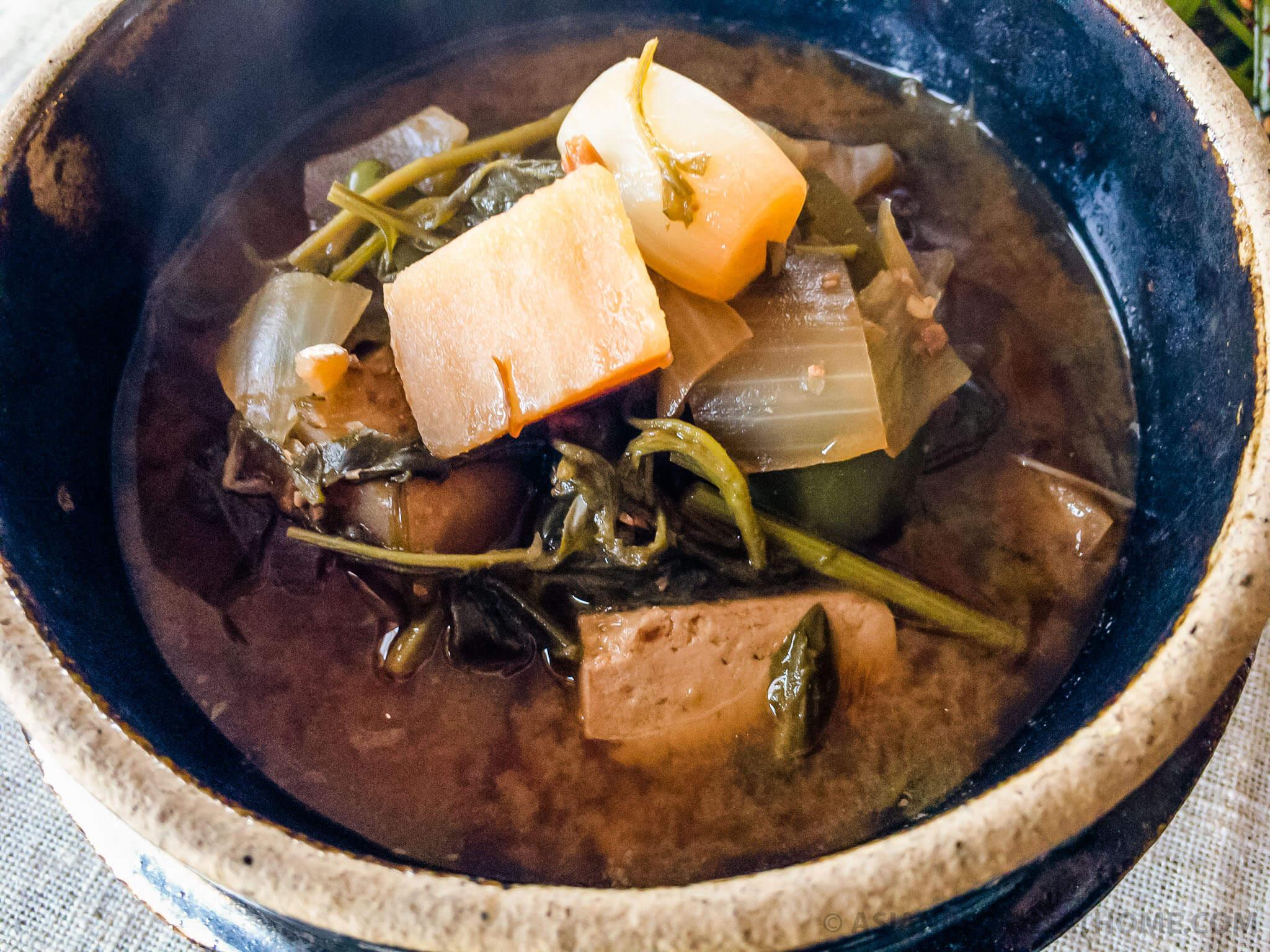 This Korean soybean paste stew (doenjang guk) is filled with delicious mugwort greens, wild Korean chives, tofu, potatoes, and the salty/umami flavors of fermented soybean paste (doenjang).