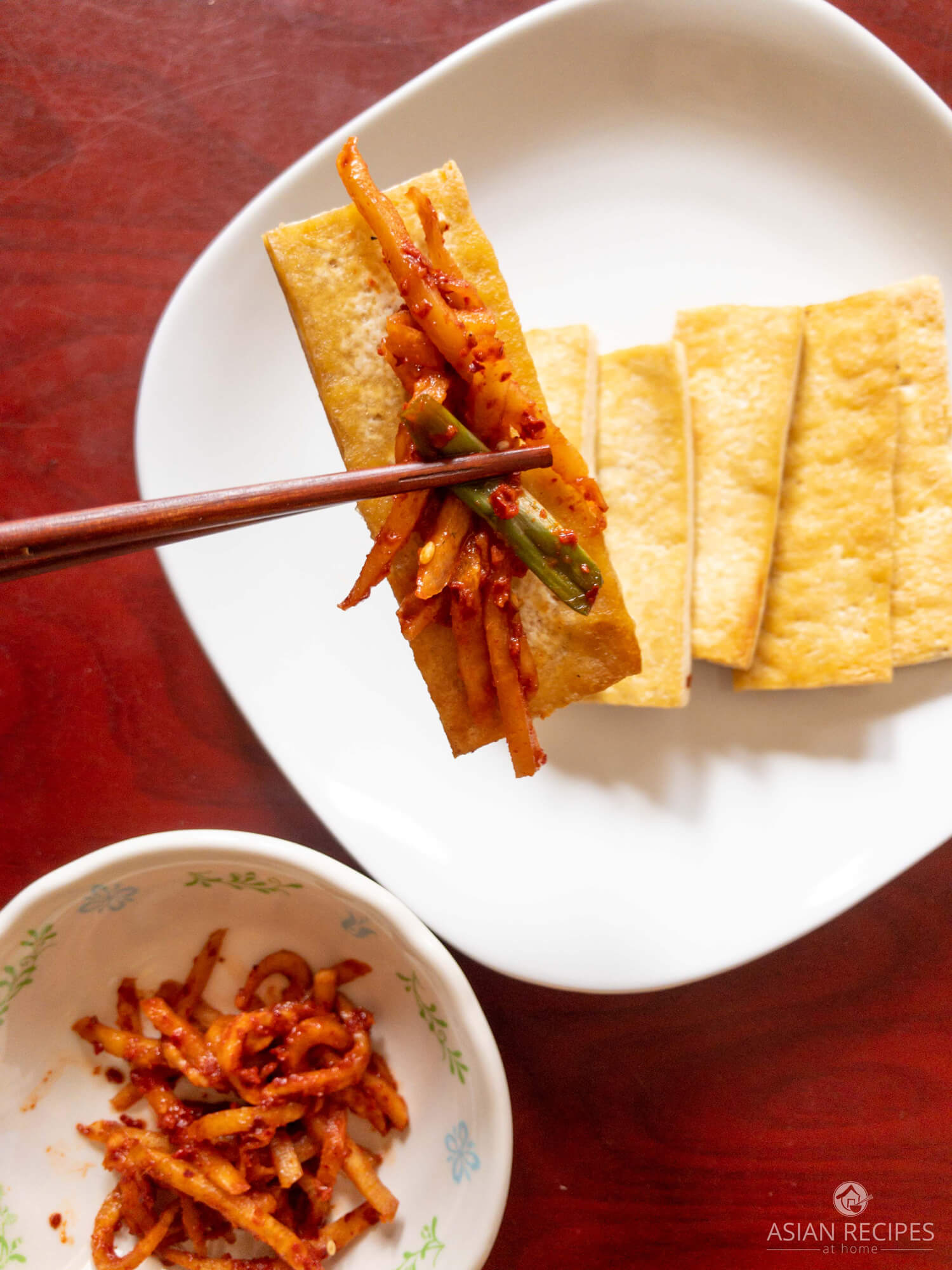 Pan-fried tofu with fresh spicy Korean radish kimchi.