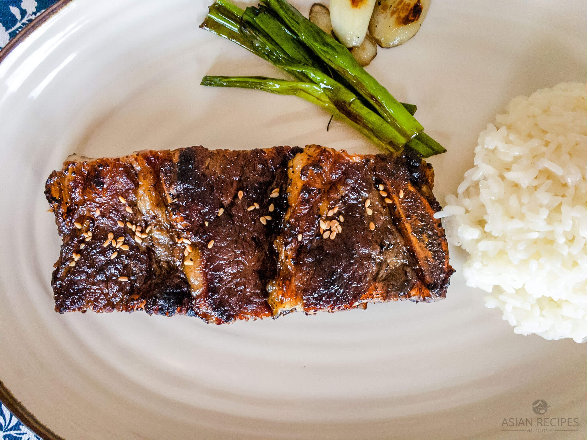 Make the best Korean BBQ short ribs (LA galbi gui) with our easy recipe. Korean-style beef short ribs are marinated in a delicious homemade marinade, and then grilled to perfection.