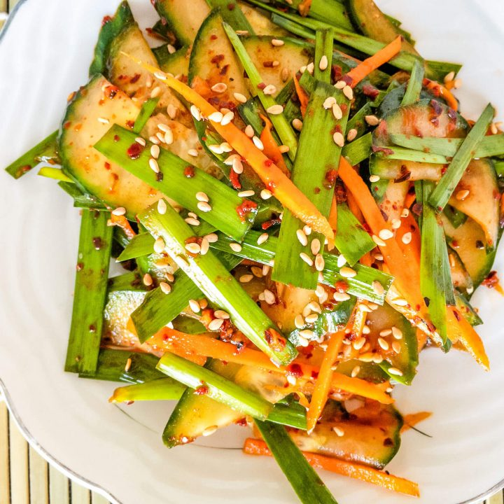 Make this fresh Korean-style cucumber and chive salad with our easy and tasty recipe. Cucumbers and garlic chives are tossed in a red hot chili pepper powder (gochugaru), soy sauce, fish sauce, garlic, and a few other common ingredients.