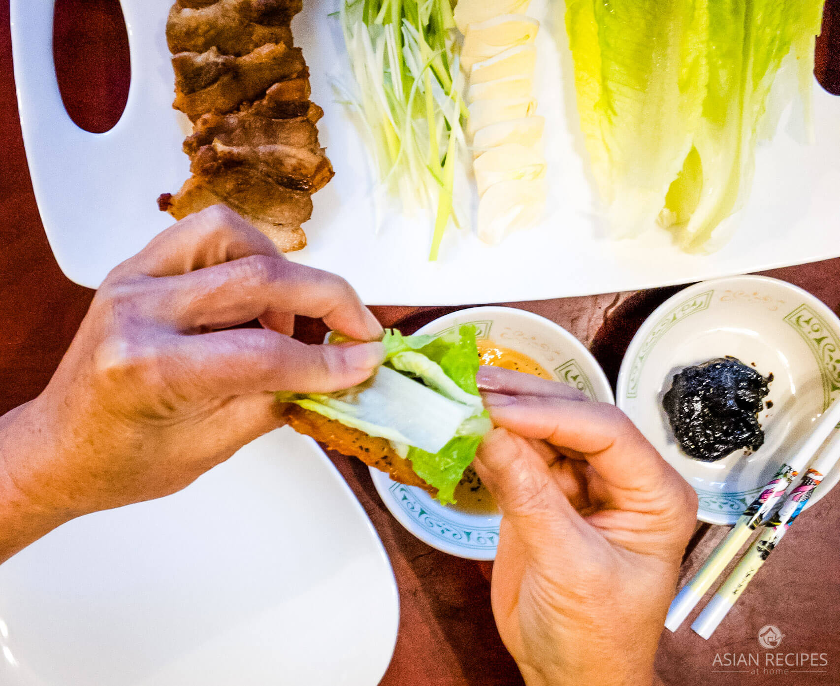 This is one of the more popular Korean BBQ options which consists of pan-fried sliced pork belly, fresh romaine lettuce leaves, sliced garlic, sesame oil, and gochujang.