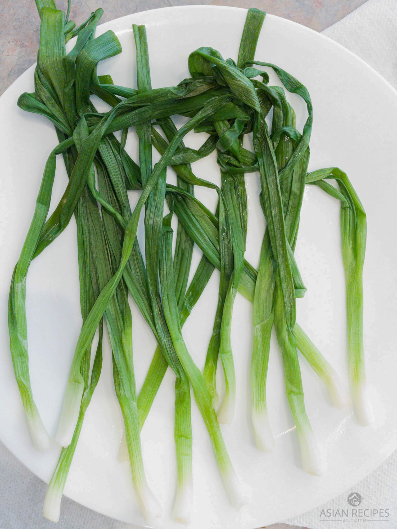 After the green onions are microwaved to make the Korean green onion side dish (pa namul) recipe