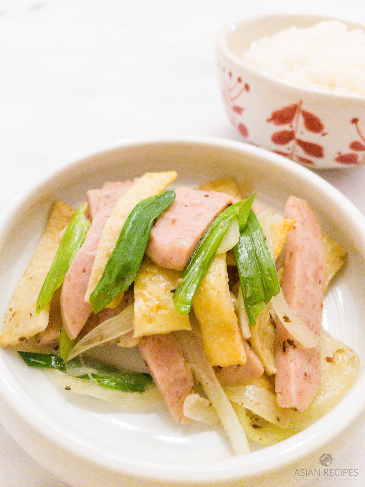 This side dish recipe is made with Spam, Korean-style flat fish cakes and onions.