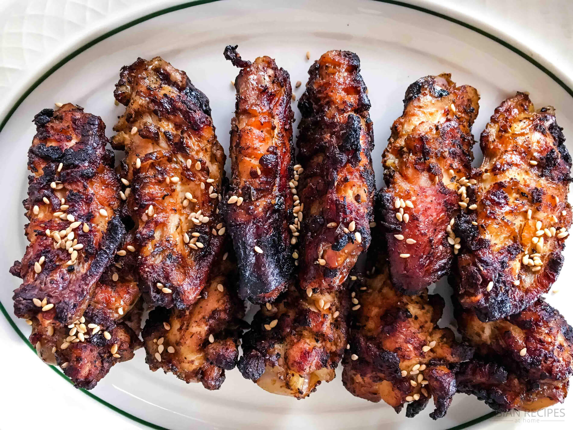 Grilled Asian-inspired chicken wings recipe ready to eat.