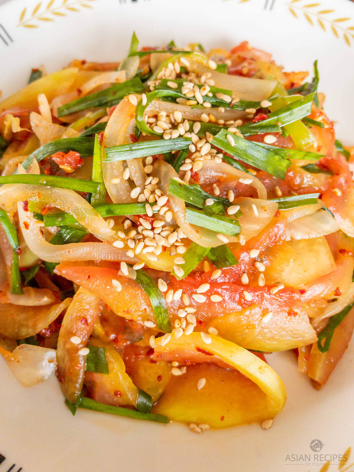 Try out our easy and quick Korean-style watermelon rind salad recipe this Summer. Thinly sliced watermelon rinds are used to create a refreshing and spicy salad.