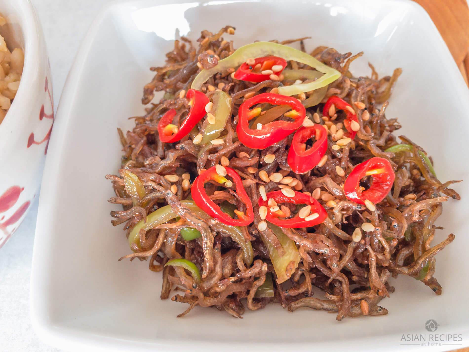 Sweet, savory, sticky, and crispy anchovies that are stir-fried to perfection!